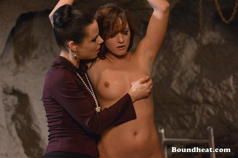 brunette mistress twists nippled of naked tied slave