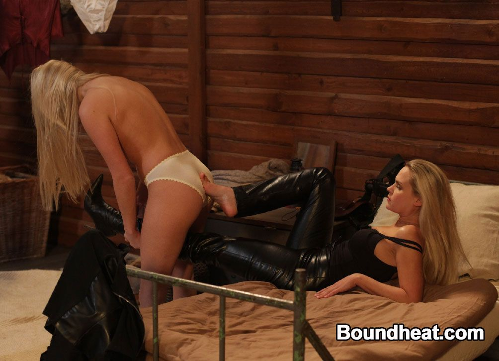 lesbian mistress on bed has teen slave stripping her