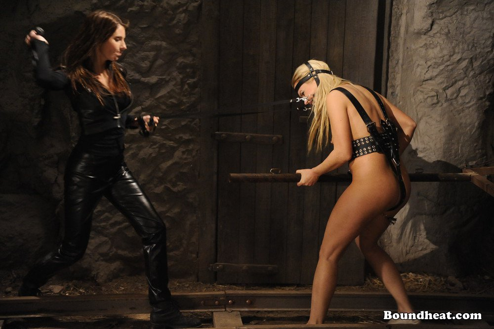Mistress dominating her slave in front of her other slaves 4