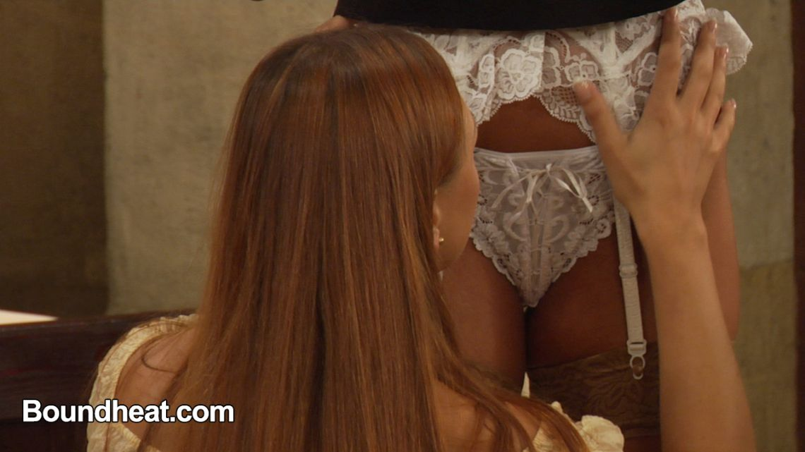 lesbian slave lifts skirt of mistress reveals white lace panties and garter belt