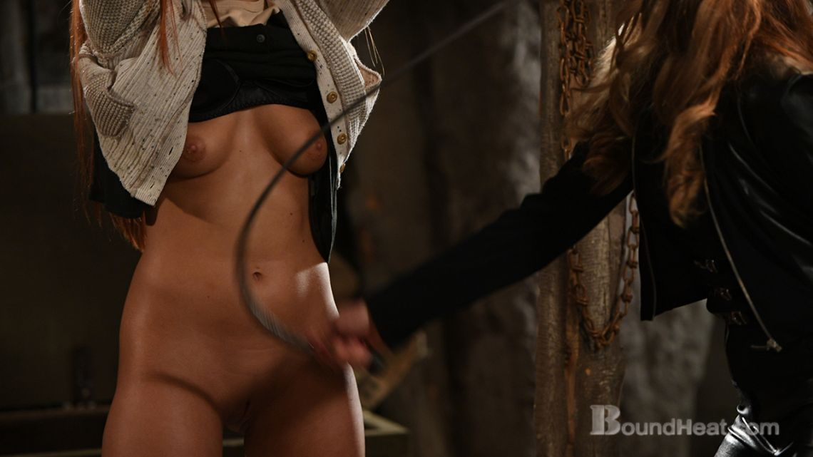 lesbian mistress whips bound slave breasts