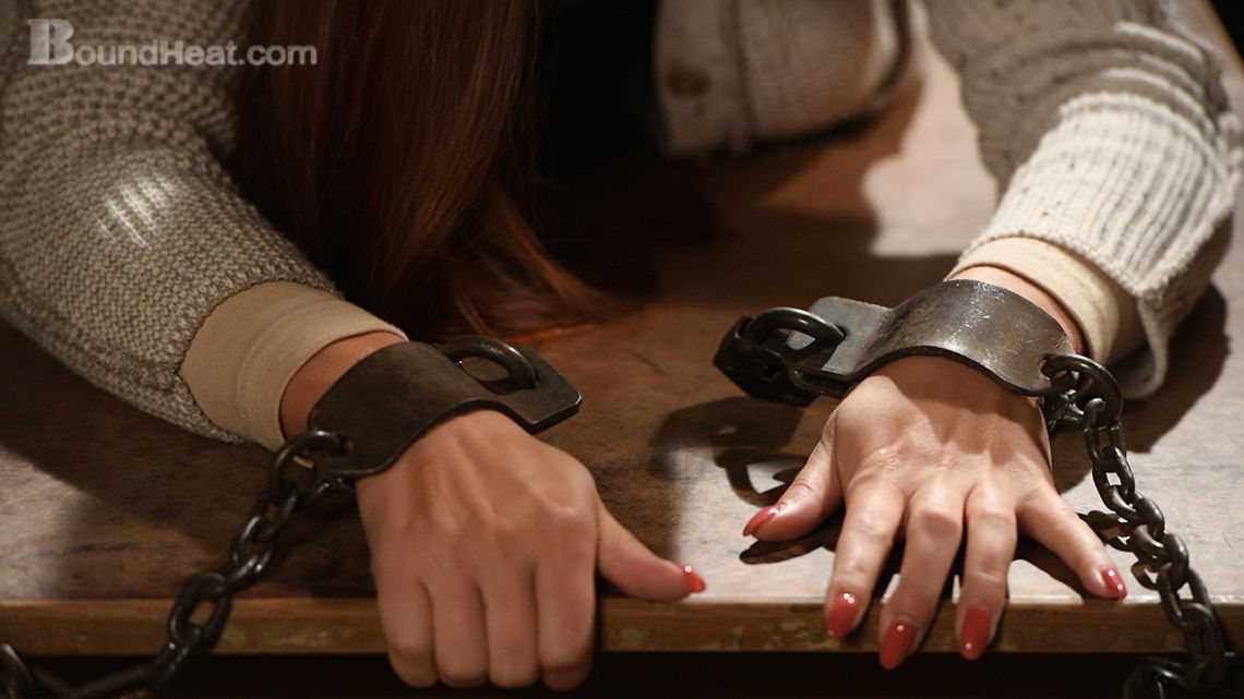 teenage lesbian slave is chained handcuffed to mistress desk
